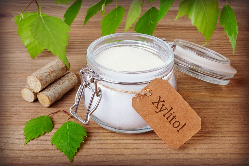 xylitol sweetener in jar with birch bark