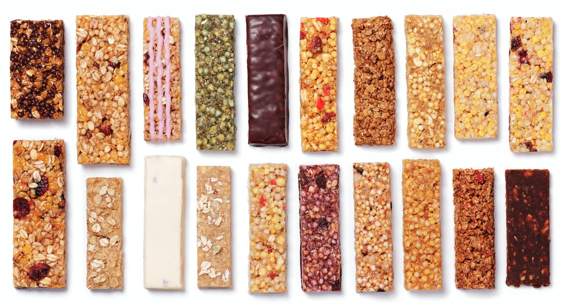 Different protein bars on white background