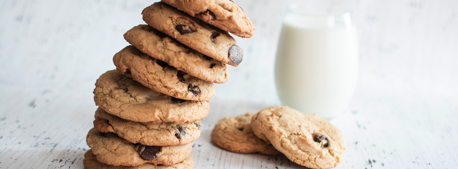 tower of chocolate chip cookies and glass of milk