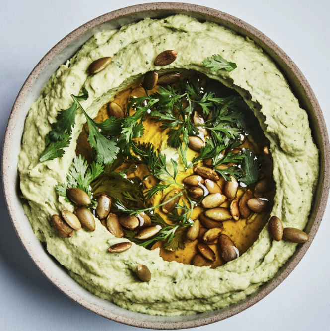 avocado hummus with nuts on top
